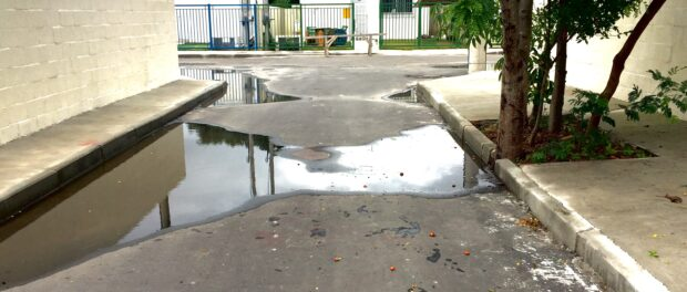 After rains, the community floods as it always has, despite hoping the asphalted streets would reduce standing water