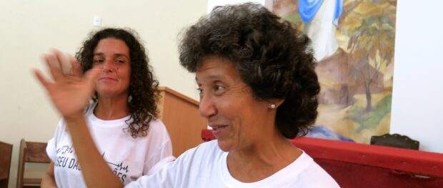 Maria da Penha and Sandra Maria tell the story of the community's resistance from inside the Catholic Church