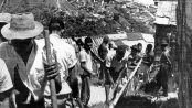 Anthony Leeds image of men building favela community. From: https://glo.bo/2oEi72j