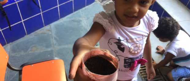 The kids painted pots made out of old plastic bottles