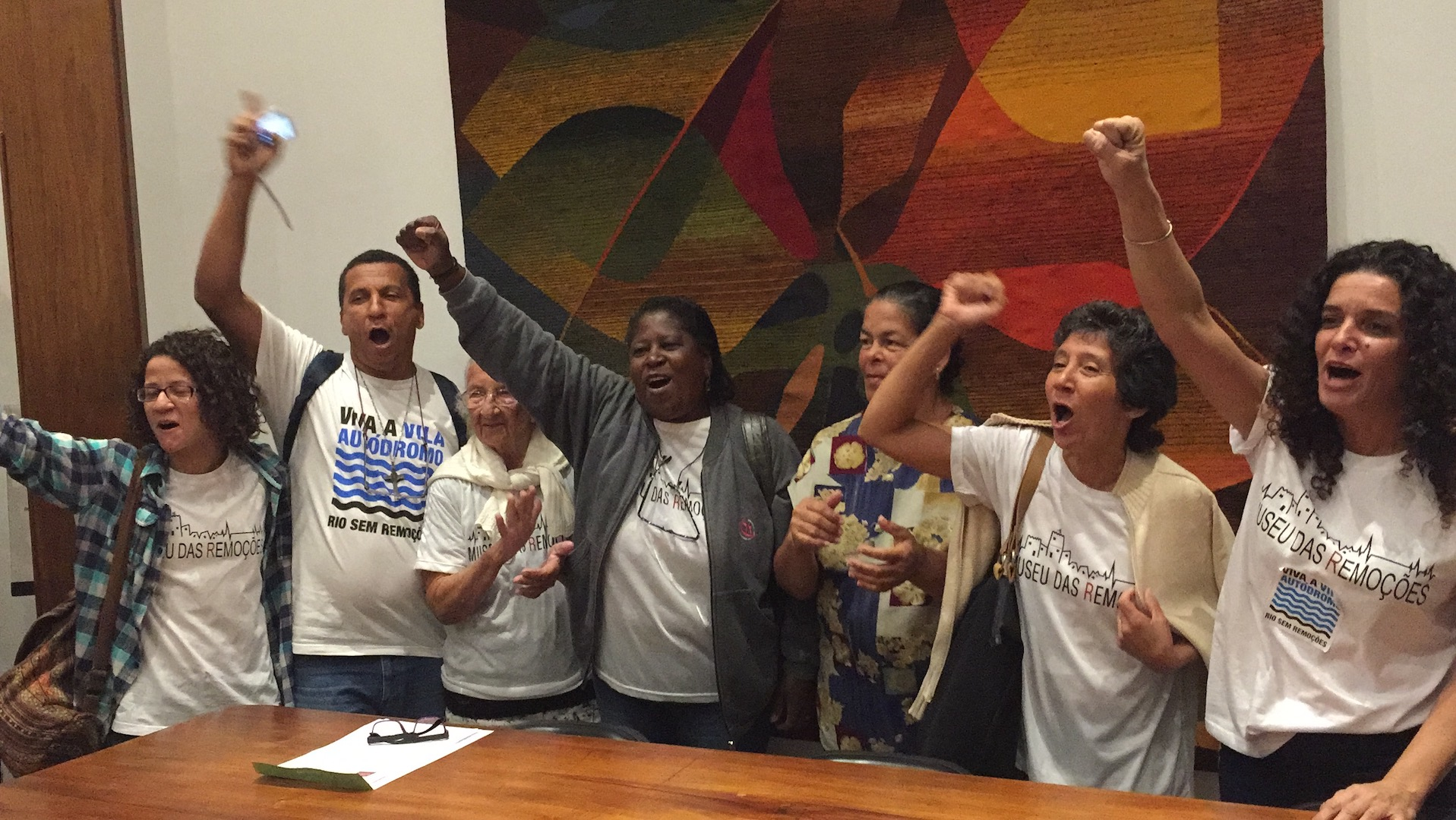 Vila Autodromo residents celebrate by showing their powerful resistance