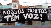 """Banner expressing commitment of the mothers to speak out: """"Our dead have a voice!"""""""