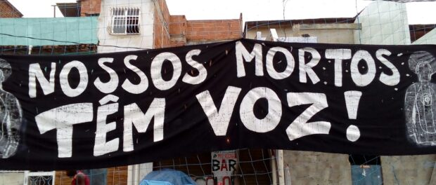 "Banner expressing commitment of the mothers to speak out: ""Our dead have a voice!"""