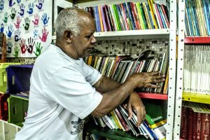 Paulo cares for the library. Photo by Hector Santos of Raizes em Movimento.
