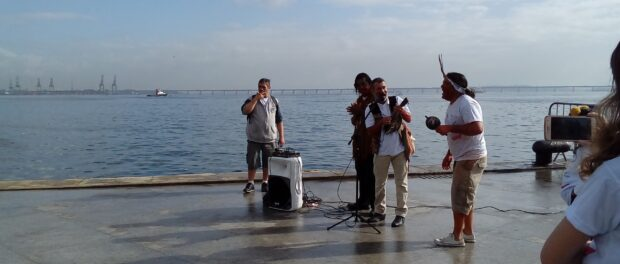 Members of indigenous communities perform songs about water and the bay