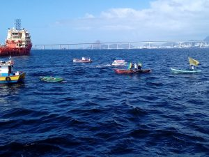 Fishing boats with protest banners