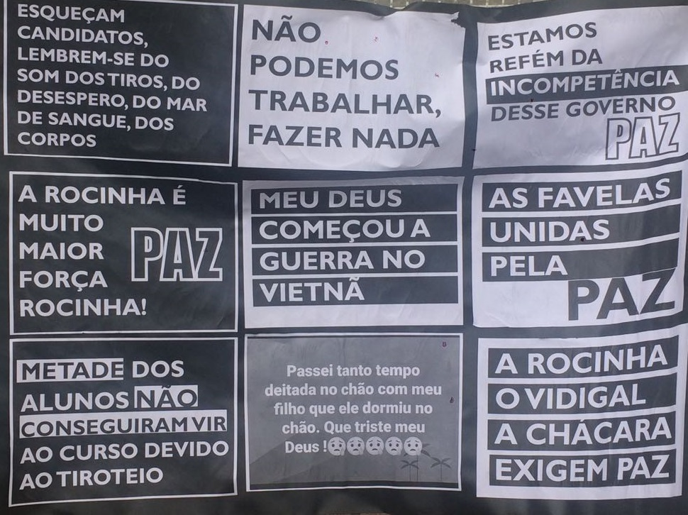 """Protest posters, including: """"Favelas united for peace,"""" and """"Half the students couldn't come to their class because of the shootout."""""""