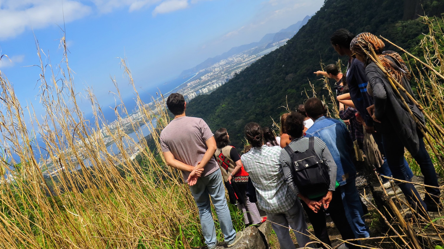 Touring the surrounding forest, the group stops to look at the view