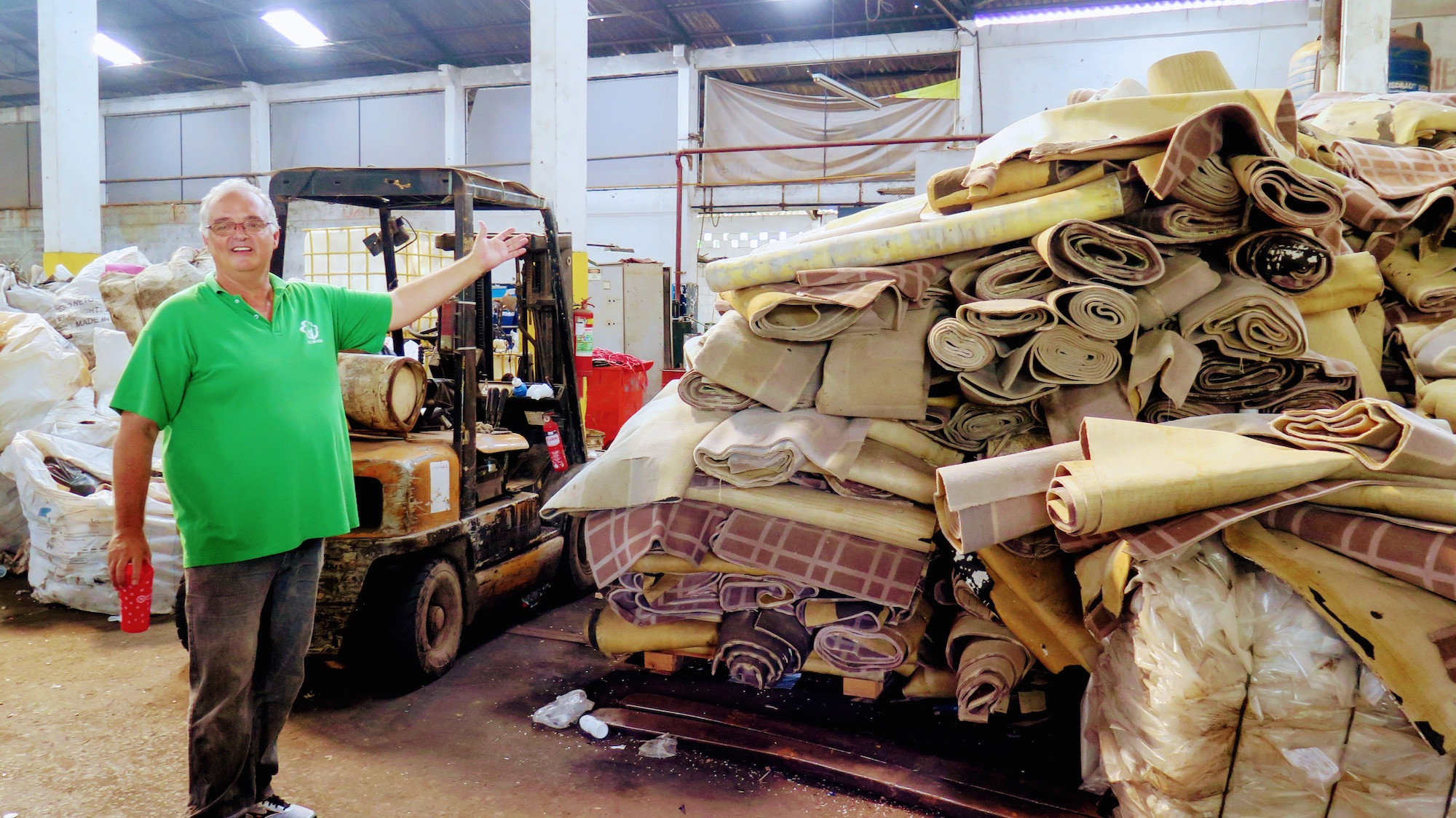 Edson shows large pile of hotel carpet to be recycled into profit