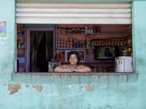 Long-time shop keeper in Rio de Janeiro's first favela, Providencia. Photo by Antoine Horenbeek