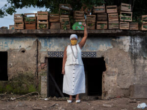 Mãe Ekedi Sílvia de Mendonça, a journalist and a Black Movement activist, in front of the old house of cult of João da Gomeia, one of the most famous candomblé priests of his time. Photo by Bárbara Dias