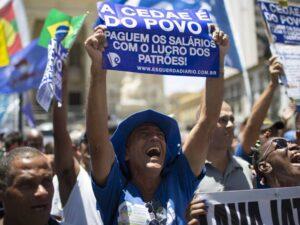 Cedae workers protest downtown Rio de Janeiro. Leo Correa/ AP 2017.
