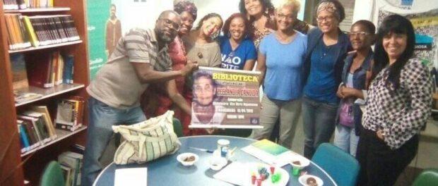 Activists and Solange Lage a consultant to the Municipal Secretariat for Culture, Leisure, Human Rights and Racial Equality of São João de Meriti, at Zeelandia Cândido Library.