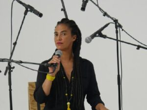 Grada in one of her art works a performance in an installations on racism. Photo by: Zé de Paiva.