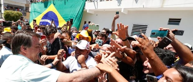 Jair Bolsonaro is greeted by supporters in Coremas, Paraiba state, northeast Brazil, last September. Photo: Brazilian Presidency/Reuters