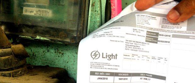 Bar owner shows far overpriced electricity bill in Rio das Pedras, a favela in Rio's West Zone, in 2018.